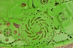 Green pattern of linked hermetical machine scrap. The details of green pattern of linked hermetical machine scrap Stock Photos