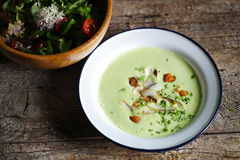 Green pea creamy soup with coconut and nuts, salad Stock Images