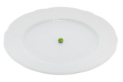 A green pea on a plate Royalty Free Stock Images