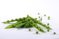 Green pea pod, green peas,. On white background royalty free stock photo