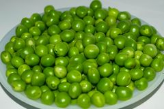 Green pea pod,green peas in a white bowl royalty free stock photos
