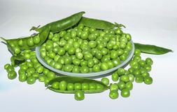 Green pea pod,green peas in a white bowl. royalty free stock photo