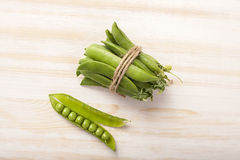 Green pea pod on wooden table Royalty Free Stock Image