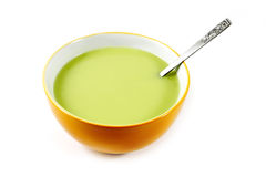 Green Pea soup in a bowl isolated Royalty Free Stock Photography