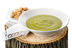 Green pea soup with croutons on the stub Royalty Free Stock Image