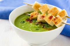 Green pea soup. With fresh herbs, pepper and croutons Stock Photos
