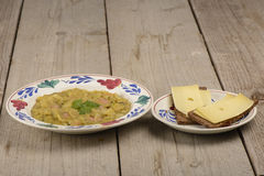 Green pea soup and rye bread Royalty Free Stock Photo