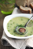 Green pea soup with sausage Stock Image