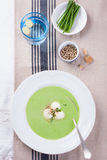 Green pea soup with spring onion and mozzarella Royalty Free Stock Photography