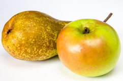 Green pear and apple. Detail of green pear and apple isolated Royalty Free Stock Photo