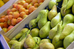Green pear and apricot fruits Stock Image