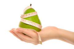 Green pear with measuring tape Royalty Free Stock Images