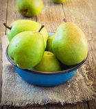 Green pear in a metal bowl Royalty Free Stock Photography