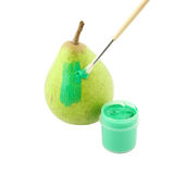 Green pear and paint isolated Royalty Free Stock Image
