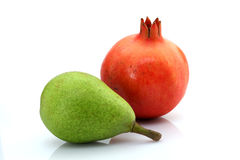 Green pear and pomegranate Stock Photo