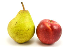 Green pear and red apple. On white background Stock Photo