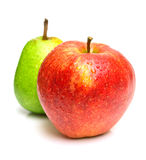 Green pear and red apple stock photo