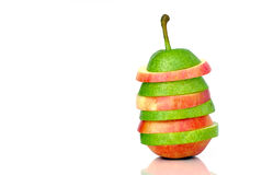Green pear and red apple slices. Before white background Royalty Free Stock Image