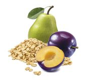 Green pear, red cherry plum and rolled oats stock photos