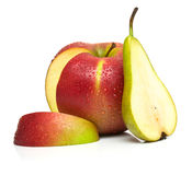 Green pear and ripe red apple Royalty Free Stock Images