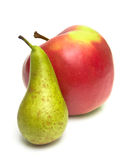 Green pear and ripe red apple Royalty Free Stock Photography
