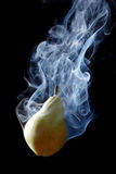 Green pear and smoke Royalty Free Stock Photo