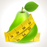 Green pear with yellow measuring tape Royalty Free Stock Image