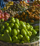 Green pears. Whole green pears and other fruits on sale at street market, Dali, Yunnan, China Stock Photography