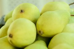 Green pears. Background. Cropped shot. The concept of proper nutrition. stock photography
