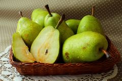 Green pears in a basket Stock Images