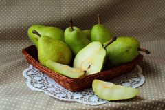 Green pears in a basket Royalty Free Stock Photo