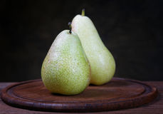 Green pears on an old kitchen table Royalty Free Stock Image