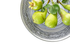 Green pears and pomegranate in oriental dish closeup Stock Photo