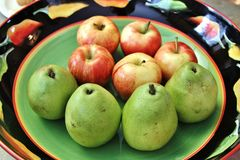 Green pears and red apples Stock Image