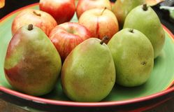 Green pears and red apples Stock Images