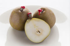Green pears with red sealing wax Stock Photo