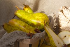 Green pears on a sackcloth Royalty Free Stock Photography