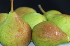Green pears with water drops on them royalty free stock images
