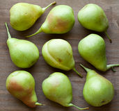 Green pears. On wooden table Stock Photos