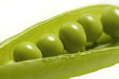 Green peas. Fresh peas close up isolated on white Stock Photography
