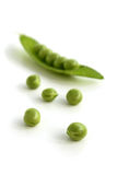 Green peas. Open pea pod and peas, a vertical picture royalty free stock image