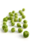 Green peas. Scattered green peas on a white background Stock Photo