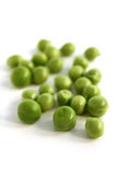 Green peas. Scattered green peas on a white background Royalty Free Stock Photos