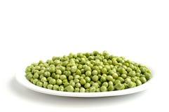 Green peas. On a white background Royalty Free Stock Photos