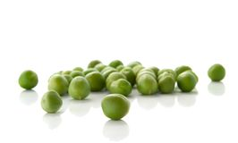 Green peas. Fresh green peas isolated over white background Stock Image