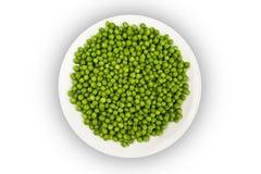 Green peas. White dish full of green peas, isolated Stock Photos