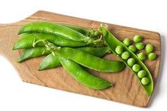 Green peas. On wood board Royalty Free Stock Photo