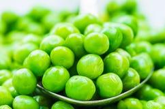 Green peas background. Stock Photo
