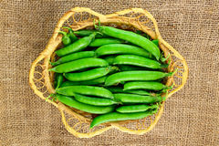 Green peas in the basket Royalty Free Stock Photography