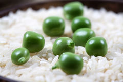Green peas and basmati rice. Beutiful macro shot of green peas and basmati rice Stock Images